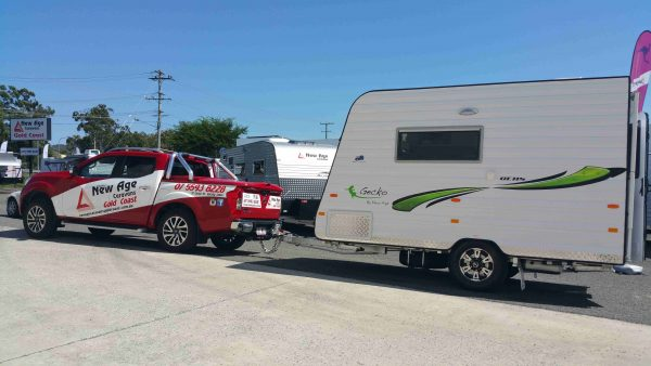compact lightweight caravan being towed