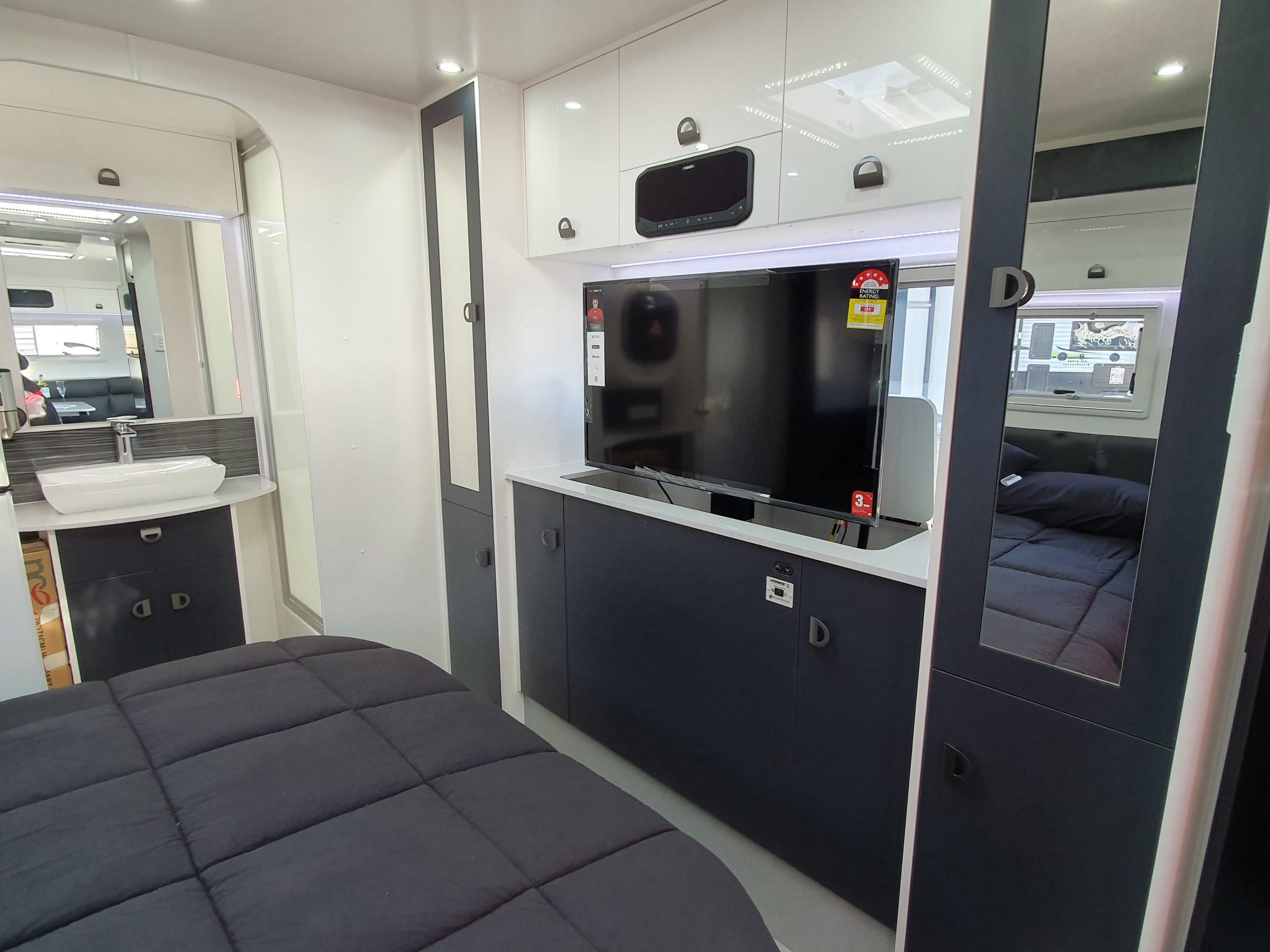 caravan bedroom and inset smart TV