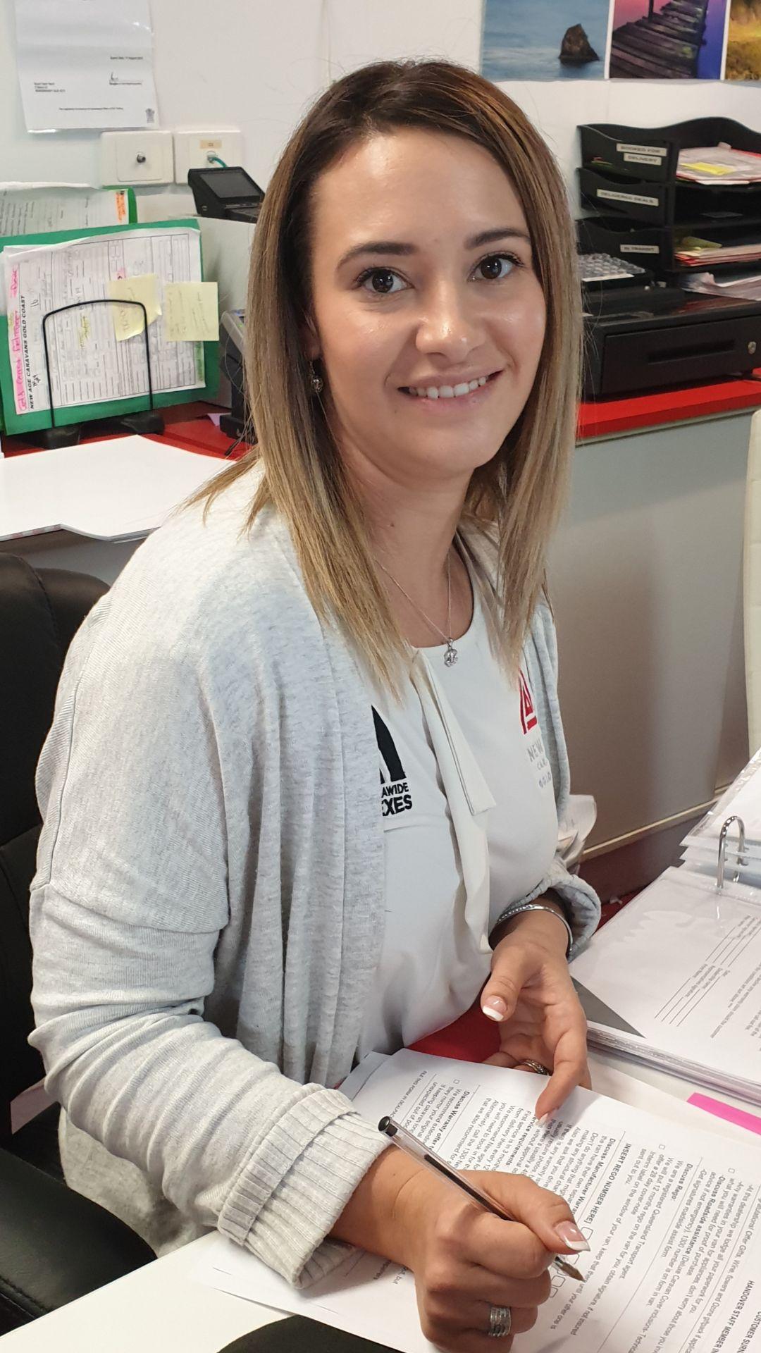 lady receptionist smiling grey cardigan