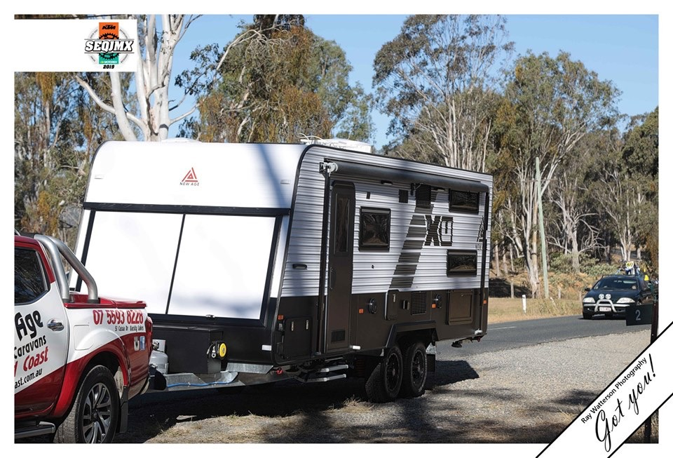 New Age toyhauler caravan towing on the road