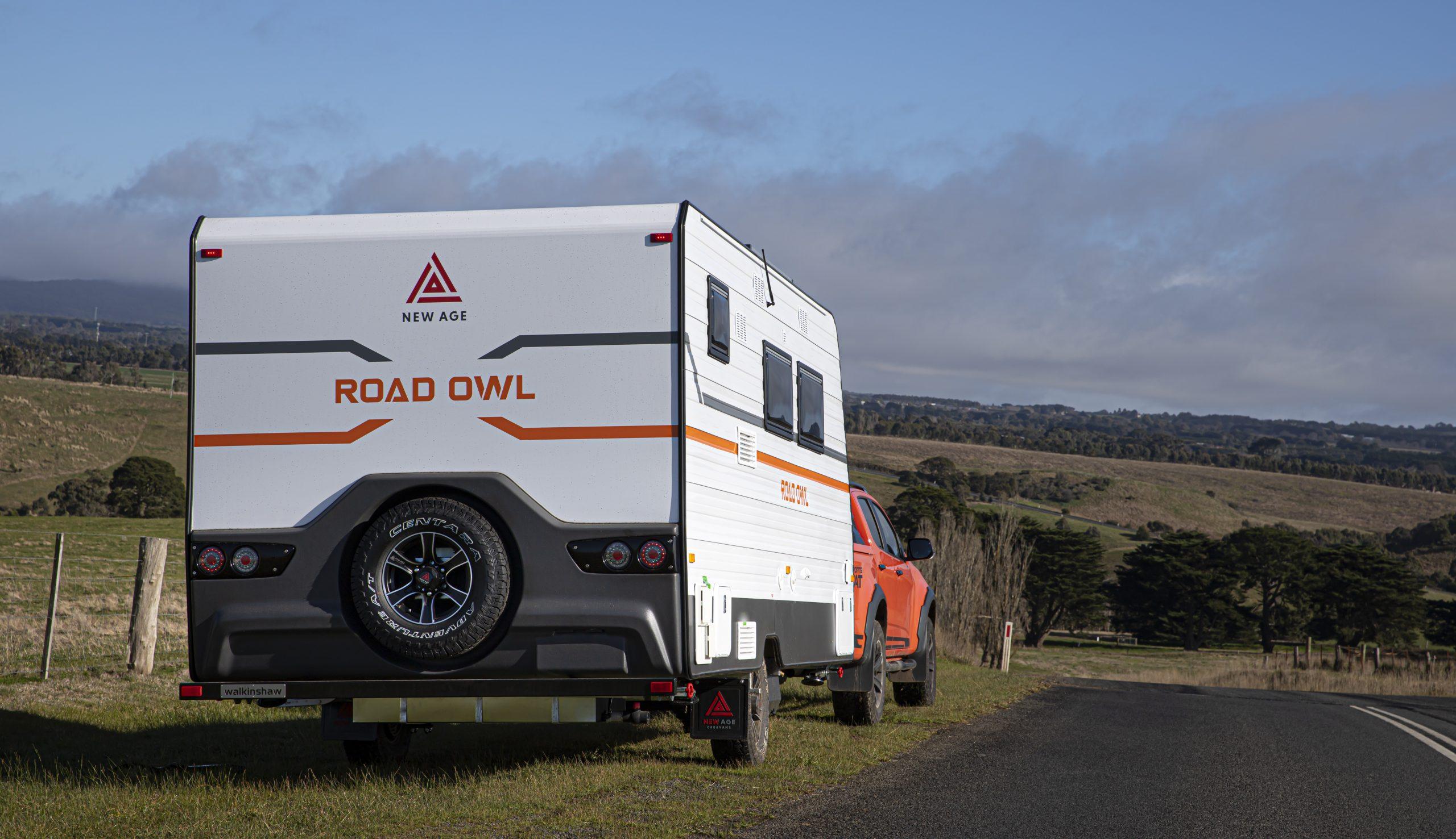 HERO image of New Age caravan driving down the highway